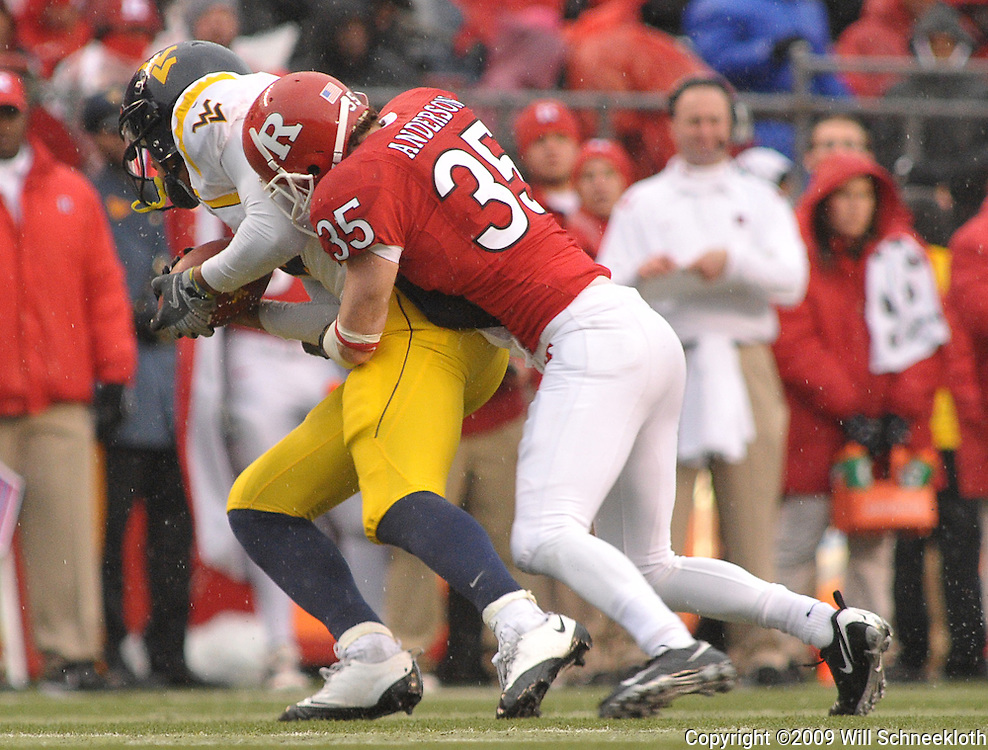 Dec 5, 2009; Piscataway, NJ, USA; Rutgers cornerback Billy Anderson (35) tackles during second half NCAA Big East college football action in West Virginia's 24-21 victory over Rutgers at Rutgers Stadium.