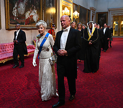 Princess Alexandra, The Honourable Lady Ogilvy and Lord Hague of Richmond arrive through the East Gallery during the State Banquet at Buckingham Palace, London, on day one of the US President's three day state visit to the UK.