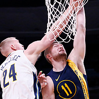 03 April 2018: Indiana Pacers center Domantas Sabonis (11) is blocked Denver Nuggets center Mason Plumlee (24) during the Denver Nuggets 107-104 victory over the Indiana Pacers, at the Pepsi Center, Denver, Colorado, USA.