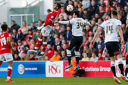 Jonathan Kodjia of Bristol City and George Thorne of Derby County compete in the air - Mandatory byline: Rogan Thomson/JMP - 19/04/2016 - FOOTBALL - Ashton Gate Stadium - Bristol, England - Bristol City v Derby County - Sky Bet Championship.