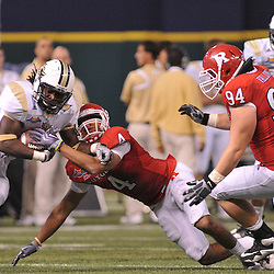 Dec 19, 2009; St. Petersburg, Fla., USA; Rutgers cornerback David Rowe (4) hits wide receiver UCF wide receiver Quincy McDuffie (14) during NCAA Football action in Rutgers' 45-24 victory over Central Florida in the St. Petersburg Bowl at Tropicana Field.