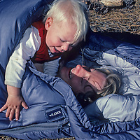 A mother and her son wake up in a sleeping bag while camping in California's Sierra Nevada.