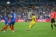 Romania Midfielder Nicolae Stanciu shoots at goal during the Group A Euro 2016 match between France and Romania at the Stade de France, Saint-Denis, Paris, France on 10 June 2016. Photo by Phil Duncan.