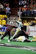 4/12/2007 - Dustin Almond (9) passes in the Frisco Thunder's 46-33 win over the Alaska Wild in the first professional football game in Alaska.
