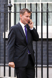 © Licensed to London News Pictures. 10/09/2013. London, UK. The Health Secretary, Jeremy Hunt, is seen on Downing Street in London today (10/09/2013) after a meeting of the British Government's cabinet. Photo credit: Matt Cetti-Roberts/LNP