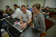 WHNPA mentor volunteer and team editor Caroline Couig, right, works with a military photographer during the editing phase of the annual DC Shoot Off photography workshop.  The workshop is a three day long weekend event that brings professionals from both aisles to support the annual non-profit education and mentoring initiative for military and civil service photographers.  Photo by Johnny Bivera