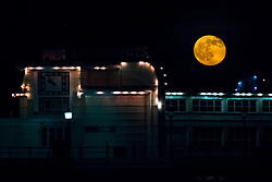 © Licensed to London News Pictures. 15/05/2014. Worthing, UK. A Deep Red Full Moon rises over Worthing Pier. xxxxx. Photo credit : Julie Edwards/LNP