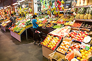 Market stalls inside historic market building in Triana, city of Seville, Spain