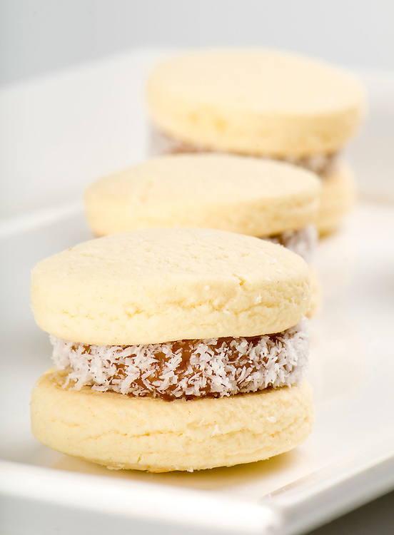 Close up of cornflour cookies filled with caramel and coconut.