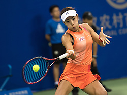 September 27, 2017 - Wang Qiang of China returns the ball during the singles third round match against Karolina Pliskova of Czech Republic at 2017 WTA Wuhan Open in Wuhan, capital of central China's Hubei Province. Wang Qiang lost 0-2. (Credit Image: © Xiong Qi/Xinhua via ZUMA Wire)