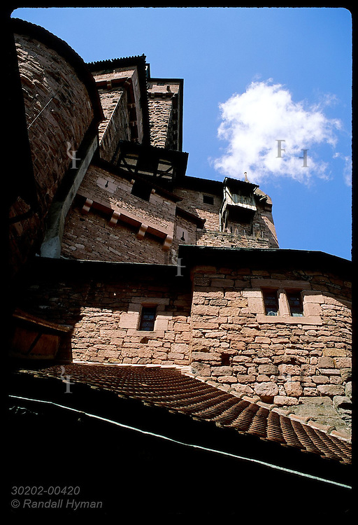 Haut Koenigsbourg castle towers against blue sky at main entry; Vosges Mountains of Alsace. France