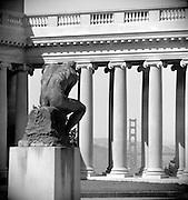 Rodin sculpture, The Thinker, at Palace of the Legion of Honor, San Francisco Golden Gate Bridge in distance