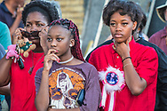 People gather at a vigil for Alton Sterling on May 2, 2017 in Baton Rouge, Louisiana held in front of  the Trilple S Food Mart U.S. the day news leaked that the Justice Department  will not prosecute thee police officer who shot and killed Sterling last summer.