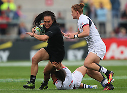 New Zealand's Portia Woodman tackled by USA's Nicole Heavirland and Alev Kelter (right) during the 2017 Women's World Cup, Semi Final match at the Kingspan Stadium, Belfast.