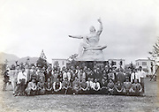 group in front of Peace Statue memorial to the atomic bomb Nagasaki Peace Park 1950s 1960s