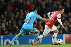 26.11.2013, The Emirates Stadium, London, ENG, UEFA CL, FC Arsenal vs Olympique Marseille, Gruppe F, im Bild Marseille's Jeremy Morel and Arsenal's Mesut Ozil compete for the ball // Marseille's Jeremy Morel and Arsenal's Mesut Ozil compete for the ball during UEFA Champions League group F match between FC Arsenal and Olympique Marseille at the The Emirates Stadium in London, Great Britain on 2013/11/26. EXPA Pictures © 2013, PhotoCredit: EXPA/ Mitchell Gunn<br /> <br /> *****ATTENTION - OUT of GBR*****