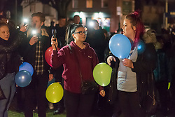 © Licensed to London News Pictures. 02/02/2018. LONDON, UK.  (R) Melissa McGuinness, sister of Josh, thanks people gathered to release dozens of lit balloons into the night sky at Harefield Green in north west London in memory of teenagers Harry Louis Rice, 17, George Toby Wilkinson, 16 and Josh McGuinness, 16.  The tribute marks seven days since the teenagers lost their lives in the Hayes car crash and the release of the balloons, timed for 8.40pm, marks the time of the crash.   Photo credit: Stephen Chung/LNP
