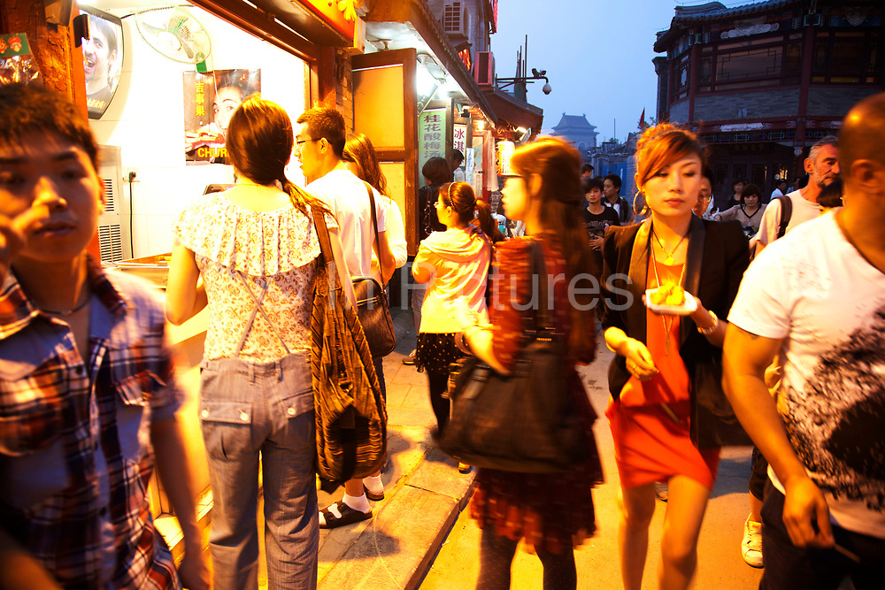 Yandaixiejie Street (meaning Tobacco Pipe Lane) in Beijing, China. Located near to Houhai in downtown Beijing, Yandai Xiejie Street is a Hutong which attracts many tourists at day and night to it's souvenir shops and towards the bar area it leads to.