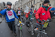 Many marchers wear images of Karla Roman - Stop Killing Cyclists stage a die-in to remember Anita Szucs, 30 and Karla Roman, 32 (both killed while cycling on Monday), and Ben Wales, 32. They are demanding investment in cycling and walking in the hope that it rises to 10% of the UK transport budget by the end of this parliament. They also point out that air pollution is poisoning millions of people in the UK and road danger means most people do not feel safe cycling on UK roads - meaning they miss out on healthy exercise and compounding a health disaster which the NHS will struggle to afford. They met outside the National Gallery and moved to the Treasury, Horse Guards Parade for protest.