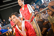 02 JULY 2006 - PHNOM PENH, CAMBODIA: A boxer and his corner crew wait to enter the ring during a traditional Khmer boxing match in Phnom Penh, Cambodia. Khmer boxing is the same sport as Muay Thai (traditional Thai kick boxing) but because off animosity between Thailand and Cambodia it is called Khmer Boxing in Cambodia. The Cambodians claim to have invented the sport, which is also practiced in Laos and Burma.   PHOTO BY JACK KURTZ