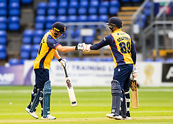 Tom Westley of Essex with team-mate Cameron Delport celebrate a four<br /> <br /> Photographer Simon King/Replay Images<br /> <br /> Vitality Blast T20 - Round 8 - Glamorgan v Essex - Friday 9th August 2019 - Sophia Gardens - Cardiff<br /> <br /> World Copyright © Replay Images . All rights reserved. info@replayimages.co.uk - http://replayimages.co.uk