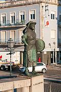 Bronze statue of a female salt worker (Salineira) overlooking the canal, Aveiro, Portugal