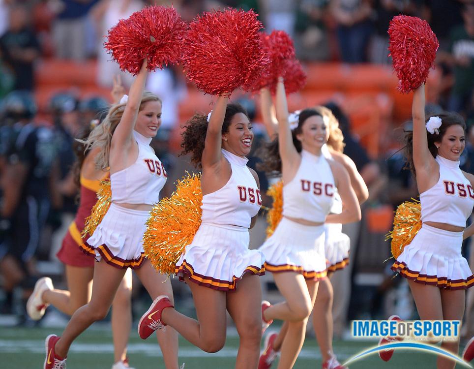 Aug 29, 2013; Honolulu, HI, USA; Southern California Trojans song girls cheerleaders lead players onto the field before the game against the Hawaii Rainbow Warriors at Aloha Stadium. USC defeated Hawaii 30-13.