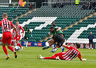 Sunderland Forward Ross Stewart (31) sliding tackle on Plymouth Argyle Defender Jerome Opoku (24)  during the EFL Sky Bet League 1 match between Plymouth Argyle and Sunderland at Home Park, Plymouth, England on 1 May 2021.
