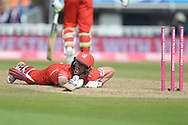 Dane Villas of Lancashire Lightning laying out stretched as he is run out by Ed Barnard during the Vitality T20 Finals Day Semi Final 2018 match between Worcestershire Rapids and Lancashire Lightning at Edgbaston, Birmingham, United Kingdom on 15 September 2018.