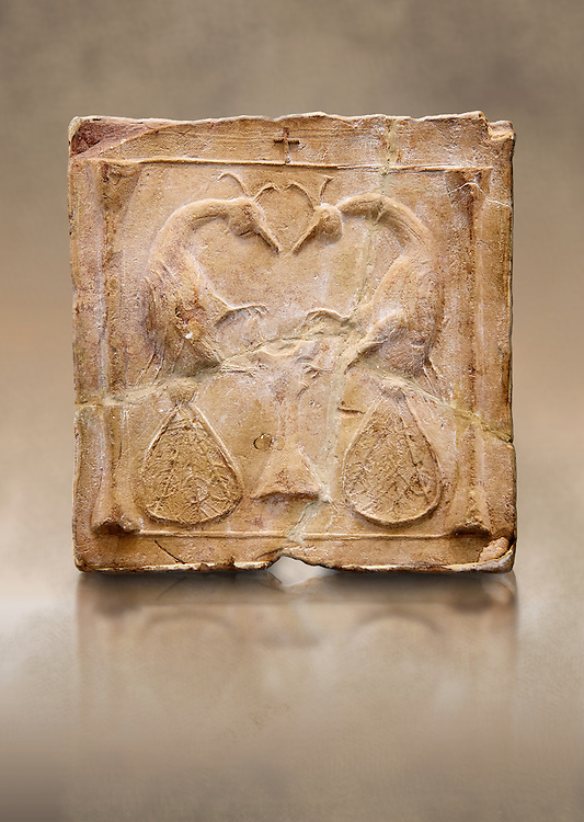 6th-7th Century Eastern Roman Byzantine  Christian Terracotta tiles depicting two Peacocks - Produced in Byzacena -  present day Tunisia. <br /> <br /> <br /> The patterns of peacock tails contain round decorations. These were seen to be the symbolic eyes of omnipotence and often ascribed to the Archangel Michael. The peacock's feather is sometimes associated with St. Barbara Also, The peacock, (due to an ancient myth that Peacock flesh did not decay), is seen as a symbol of immortality.<br /> <br /> These early Christian terracotta tiles were mass produced thanks to moulds. Their quadrangular, square or rectangular shape as well as the standardised sizes in use in the different regions were determined by their architectonic function and were designed to facilitate their assembly according to various combinations to decorate large flat surfaces of walls or ceilings. <br /> <br /> Byzacena stood out for its use of biblical and hagiographic themes and a richer variety of animals, birds and roses. Some deer and lions were obviously inspired from Zeugitana prototypes attesting to the pre-existence of this province's production with respect to that of Byzacena. The rules governing this art are similar to those that applied to late Roman and Christian art with, in the case of Byzacena, an obvious popular connotation. Its distinguishing features are flatness, a predilection for symmetrical compositions, frontal and lateral representations, the absence of tridimensional attitudes and the naivety of some details (large eyes, pointed chins). Mass production enabled this type of decoration to be widely used at little cost and it played a role as ideograms and for teaching catechism through pictures. Painting, now often faded, enhanced motifs in relief or enriched them with additional details to break their repetitive monotony.<br /> <br /> The Bardo National Museum Tunis, Tunisia