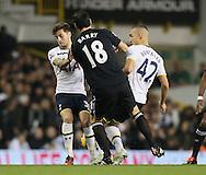 Tottenham's Ryan Mason and Nabil Bentaleb tussle with Everton's Gareth Barry<br /> <br /> Barclays Premier League- Tottenham Hotspur vs Everton - White Hart Lane - England - 30th November 2014 - Picture David Klein/Sportimage