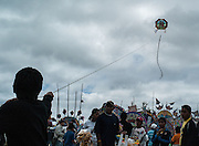 The kites in flight symbolize the communication between the living and the dead.