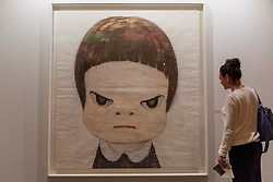 """© Licensed to London News Pictures. 29/06/2016. London, UK.  A woman looks at """"Punch me harder"""" by Yoshitomo Nara at the preview, in Chelsea, of Masterpiece London, the leading international fair for art and design from antiquity to the present day with works from 154 world-renowned exhibitors on sale.  The fair is open until 6 July.Photo credit : Stephen Chung/LNP"""