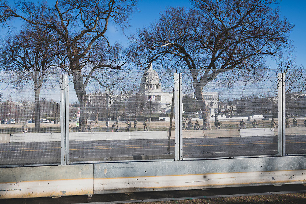 Washington DC, USA - January 21, 2021: View through the fence surrounding the Capitol Building of National Guard troops providing security the day after the Biden inauguration.