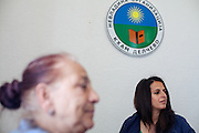Paralegal Romina Kajtazova in conversation with NGO Kham client Sazije Fazlievik at the office of the organisation in the city of Delcevo, Macedonia.