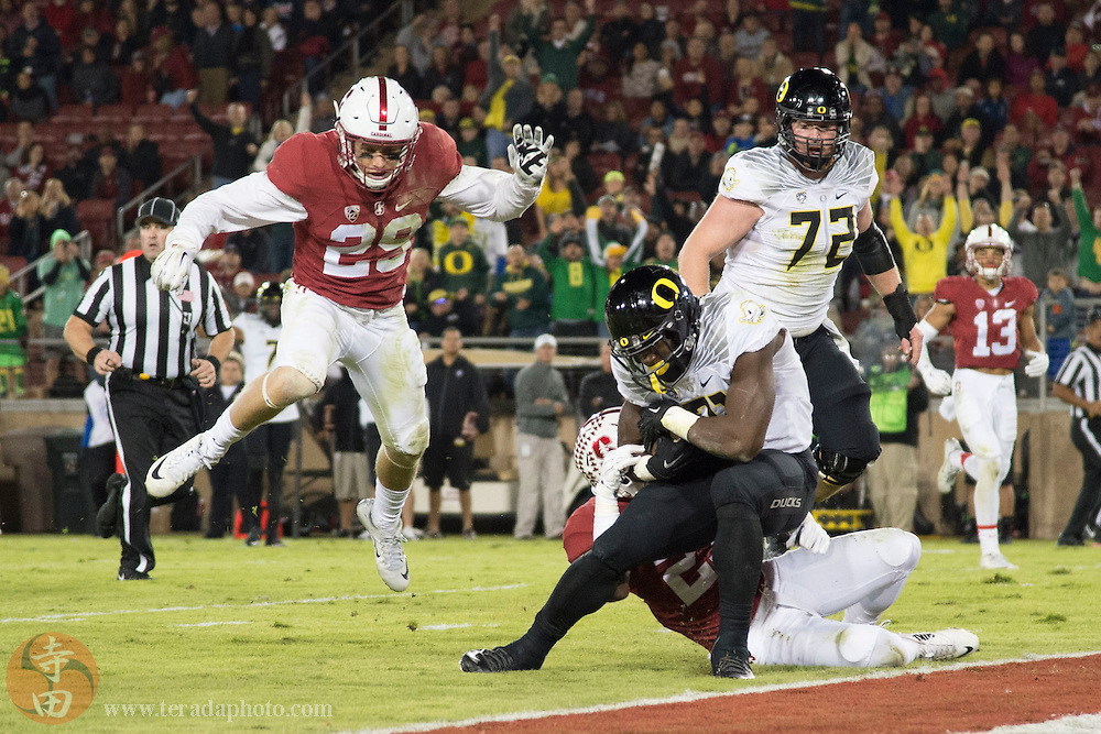November 14, 2015; Stanford, CA, USA; Oregon Ducks running back Royce Freeman (21) scores a touchdown against the Stanford Cardinal during the third quarter at Stanford Stadium. The Ducks defeated the Cardinal 38-36.