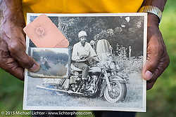 """Jimmie """"Mr Jemma"""" Harris holds some old photos of himself with his original motorcycle license at the annual """"Founders Picnic"""" with the Flying Eagles MC (founded 1950). Sykesville, MD, USA. August 16, 2015.  Photography ©2015 Michael Lichter."""