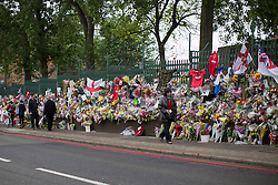 © licensed to London News Pictures. London, UK 29/05/2013.Members of the public paying her respects at the scene where Drummer Lee Rigby was murdered by two men in Woolwich town centre. Photo credit: Tolga Akmen/LNP