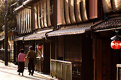 Old street with traditional wooden houses in Gion district of Kyoto Japan Views of old wooden buildings in historic Gion district of Kyoto Japan