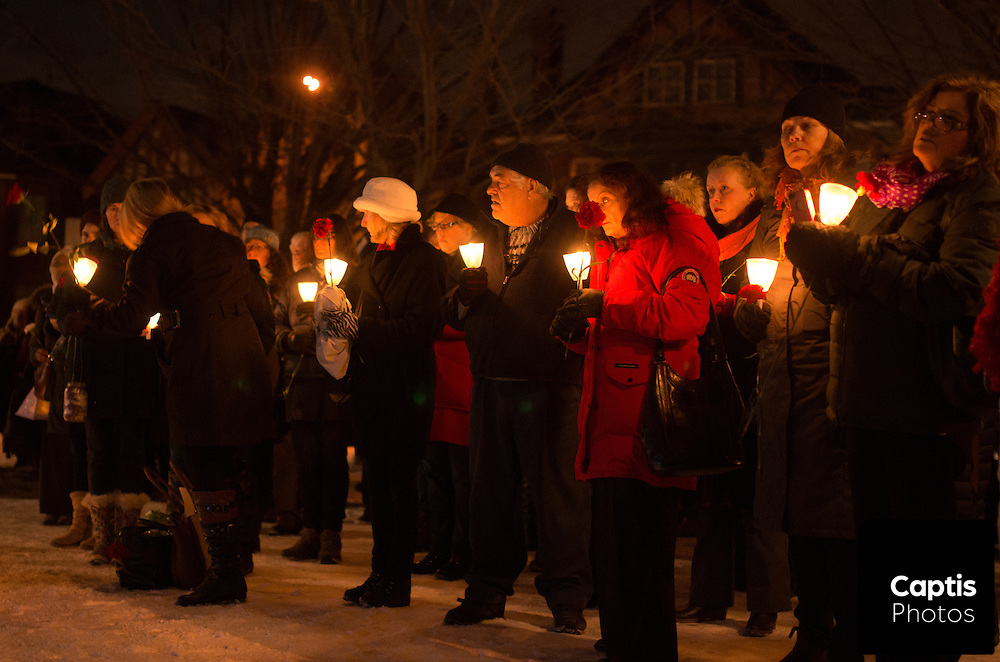 People hold candle during the vigil. December 6, 2014.