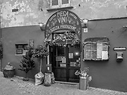 """Luino, Lombardia. ITALY.   """"Luino Old Town"""" Highly decorated Bar/Restaurant , tables laid out for lunch time clients narrow streets, hilly, situated, on the side of Lake Maggiore, Province of Varese.. ITALY <br /> <br /> <br /> Monday  02/01/2017  <br /> <br /> © Peter SPURRIER,<br /> <br /> <br /> LEICA CAMERA AG LEICA Q (Typ 116). ISO 100  f1.7  28mm"""
