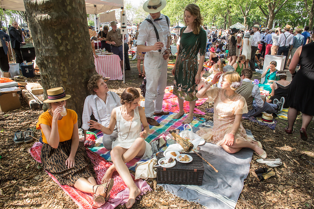 A group of friends picnics under a plane tree at the Jazz Age Lawn Party.