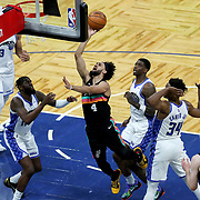 ORLANDO, FL - APRIL 12: Derrick White #4 of the San Antonio Spurs drives to the net past James Ennis III #11, Dwayne Bacon #8 and Wendell Carter Jr. #34 of the Orlando Magic during the first half at Amway Center on April 12, 2021 in Orlando, Florida. NOTE TO USER: User expressly acknowledges and agrees that, by downloading and or using this photograph, User is consenting to the terms and conditions of the Getty Images License Agreement. (Photo by Alex Menendez/Getty Images)*** Local Caption *** Derrick White; James Ennis III; Dwayne Bacon; Wendell Carter Jr.