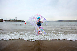 © Licensed to London News Pictures. 01/01/2016. Scarborough UK. Daring dipper Kat Tully took to the North Sea in Scarborough on the first day of the year for the Annual New Year's day dip.Photo credit: Andrew McCaren/LNP
