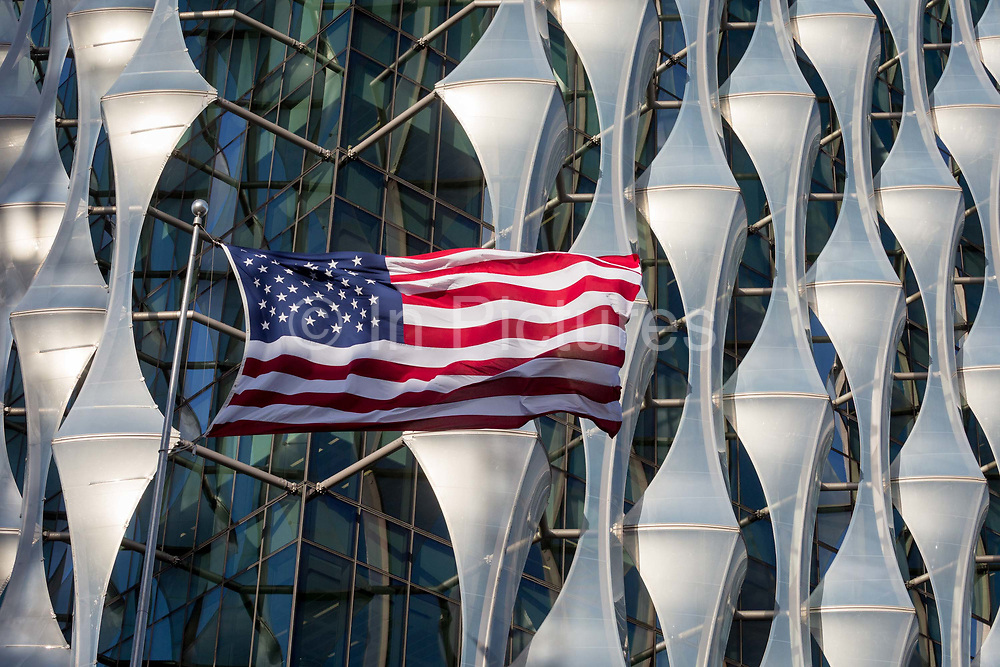 The Stars and Stripes flies over the US Embassy at Nine Elms in south London, on 16th January 2018, in London, England. On the day when the consulate opened for public business visa applications etc., after its controversial move from Grosvenor Square in central London to the south bank and which President Trump has refused to officially open.