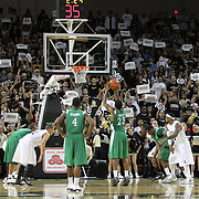 Marshall guard Shaquille Johnson (23) shoots a free throw during a Conference USA NCAA basketball game between the Marshall Thundering Herd and the Central Florida Knights at the UCF Arena on January 5, 2011 in Orlando, Florida. Central Florida won the game 65-58 and extended their record to 14-0.  (AP Photo/Alex Menendez)