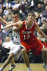 29 January 2011: Mitch Thompson get position on Jordan Zimmer during an NCAA basketball game between the Carthage Reds and the Illinois Wesleyan Titans at Shirk Center in Bloomington Illinois.