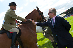 © Licensed to London News Pictures. 24/07/2017. Llanelwedd, UK. In the Main Ring. Michael Gove MP. Secretary of State for Environment, Food and Rural Affairs visits the Royal Welsh Show.The Royal Welsh Agricultural Show is hailed as the largest & most prestigious event of its kind in Europe. In excess of 200,000 visitors are expected this week over the four day show period. The first ever show was at Aberystwyth in 1904 and attracted 442 livestock entries. Photo credit: Graham M. Lawrence/LNP