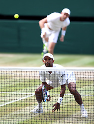 Raven Klaasen and Michael Venus during the Gentlemen's Doubles Final on day twelve of the Wimbledon Championships at the All England Lawn Tennis and Croquet Club, Wimbledon.