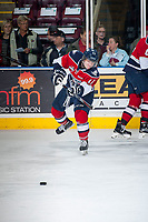 KELOWNA, CANADA - MARCH 27: Ty Comrie #11 of Tri-City Americans warms up passing the puck against the Kelowna Rockets on March 27, 2015 at Prospera Place in Kelowna, British Columbia, Canada.  (Photo by Marissa Baecker/Getty Images)  *** Local Caption *** Ty Comrie;